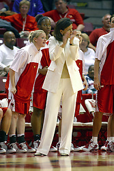 12 March 2005<br /> <br /> Robin Pingeton claps with approval of her teams performance.  Ashley Sandstead shouts some words of encouragement.<br /> <br /> 8th seed and Tournament Host, Illinois State University Redbirds, played spoiler and best the #1, #2 & #4 ranked teams to win the Missouri Valley Confernce Hoops in the Heartland Tournament.  In the final game today, the Redbirds bested the #2 seeded Indiana State University Sycamores by 2 points with a .8 second to go buzzer beater jump shot from the middle of the lane.  The Redbirds get an automatic birth to the NCAA Tournament. The Redbirds last played in the NCAA Tournament in 1989.  Hoops in the Heartland was held at Redbird Arena, Illinois State University, Normal IL