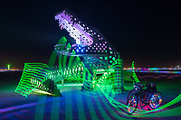 Lil Al from: New Orleans, LA year: 2015 (with light painting by me)<br /> <br /> Lil Al is a A 60′ long roaring wooden alligator effigy and symbol of the NOLA burners coming together as a community. It's a group effort that raises awareness of our love for each other, Mardi Gras, and Burning Man. The first rendition of this art was created to represent our spirit at the T-Bois Blues Festival in Larose, Louisiana about an hour south of New Orleans on a family owned alligator farm. This installation is the embodiment of how Burning Man can bring so many wonderful people together like family and encourage them to drive a giant lizard 2,000 miles across the country just to watch it burn among friends. Contact: steelebrennan0@gmail.com