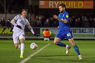 AFC Wimbledon midfielder Anthony Wordsworth (40) battles for possession with Peterborough United attacker Callum Cooke (14) during the EFL Sky Bet League 1 match between AFC Wimbledon and Peterborough United at the Cherry Red Records Stadium, Kingston, England on 12 March 2019.