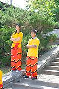 Asian dragon leg dancers waiting their turn to perform. Dragon Festival Lake Phalen Park St Paul Minnesota USA