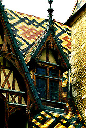 France: The roof of Hotel-Dieu, famous medieval hospital at Beaune, Burgundy...Photo Copyright Lee Foster, 510/549-2202, lee@fostertravel.com, www.fostertravel.com...Photo #: frburg105
