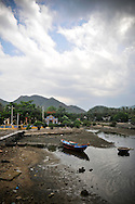 Boat lashed down on a shore of Khanh Hoa area, Vietnam, Asia