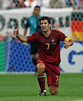 Photo: Glyn Thomas.<br />Portugal v Iran. Group D, FIFA World Cup 2006. 17/06/2006.<br /> Portugal's Luis Figo.