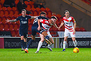 Michael Klass of Southend United (20) wrestles with Ben Whiteman of Doncaster Rovers (8) during the EFL Sky Bet League 1 match between Doncaster Rovers and Southend United at the Keepmoat Stadium, Doncaster, England on 12 February 2019.