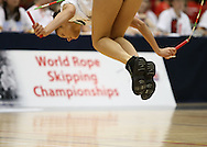 Loughborough, England - Saturday 31 July 2010: A competitor completes a sumersault in the single rope freestyle event during the World Rope Skipping Championships held at Loughborough University, England. The championships run over 7 days and comprise junior categories for 12-14 year olds in the World Youth Tournament, 15-17 year olds male and female championships, and any age open championships. In the team competitions, 6 events are judged, the Single Rope Speed, Double Dutch Speed Relay, Single Rope Pair Freestyle, Single Rope Team Freestyle, Double Dutch Single Freestyle and Double Dutch Pair Freestyle. For more information check www.rs2010.org. Picture by Andrew Tobin/Picture It Now.