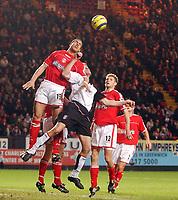 Photo. Daniel Hambury.<br /> Barclays Premiership.<br /> Charlton Athletic v Fulham. 20/12/2004.<br /> Charlton's Talal El Karkouri clears from Fulham's Brian McBride