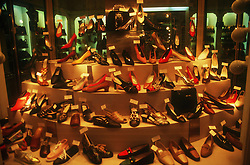 Large display of shoes in shoe shop window,