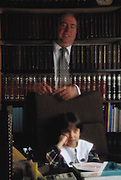 Cryonics: Lawyer, F. Zinn and daughter in his home office. Cryonics is a speculative life support technology that seeks to preserve human life in a state that will be viable and treatable by future medicine. MODEL RELEASED 1987.