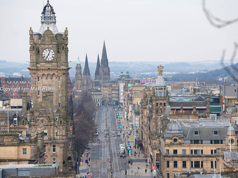 Edinburgh, Scotland, UK. 23 March 2020. A very quiet Princes Street during start of Monday morning rush hour in Edinburgh. Very little private traffic on the city's streets and a much reduced bus service is in operation as the population stay at home. Iain Masterton/Alamy Live News.