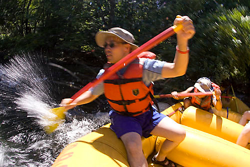 Group of people rafting down the South Fork of the American River. Coloma, CA