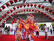26 JANUARY 2017 - BANGKOK, THAILAND:  Chinese New Year, also called Tet, celebrations at Emporium, a high end shopping mall in Bangkok. 2017 is the Year of the Rooster in the Chinese zodiac. This year's Lunar New Year festivities in Bangkok were toned down because many people are still mourning the death Bhumibol Adulyadej, the Late King of Thailand, who died on Oct 13, 2016. Chinese New Year is widely celebrated in Thailand, because ethnic Chinese are about 15% of the Thai population.      PHOTO BY JACK KURTZ