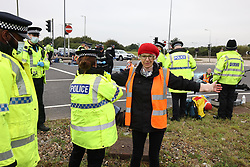 © Licensed to London News Pictures. 20/09/2021. Welwyn Garden City, UK. A protester being arrested. Protesters from Insulate Britain attempt to blockade the A1M junction 4 near Welwyn Garden City, Hertfordshire. Climate change activists Environmental protest group Insulate Britain have successfully blocked traffic at various points of the M25 on several occasions over the past week. Photo credit: Ben Cawthra/LNP