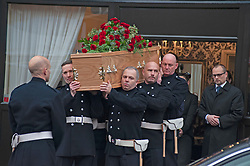 ©Licensed to London News Pictures 30/01/2020<br /> Orpington, UK. Firefighters carrying the coffin. Funeral procession leaving from funeral directors Valentine and Turner in Orpington high Street,Kent. The Funeral of thirty three year old father-of-four and firefighter Anthony Knott from Orpington,Kent. His body was found in the water at Denton Island, Sussex three weeks after he went missing on a night out in Lewes, East Sussex in December 2019. Photo credit: Grant Falvey/LNP