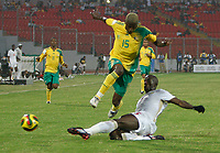 Photo: Steve Bond/Richard Lane Photography.<br />Senegal v South Africa. Africa Cup of Nations. 31/01/2008. Sibusiso Zuma (upper) is tackled by Souleymane Diawara (lower)