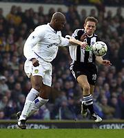 Photo: Greig Cowie<br />Barclaycard Premiership, Leeds v Newcastle, 21/02/2002<br />Craig Bellamy puts the preassure on Michael Dubbery