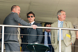 © Licensed to London News Pictures. 31/07/2014. Chichester, UK Hollywood actor Tom Cruise chats to fellow racegoers.  Ladies Day at Glorious Goodwood at Goodwood racecourse in Chichester today 31/07/14. Photo credit : Stephen Simpson/LNP