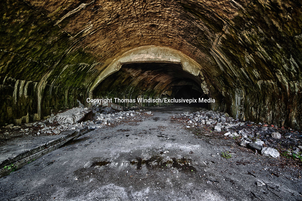 """Abandoned Europe's largest underground airport and military air base<br /><br />Željava Air Base, situated on the border between Croatia and Bosnia and Herzegovina under Plješevica Mountain, near the city of Bihać, Bosnia, was the largest underground airport and military air base in the former Yugoslavia, and one of the largest in Europe. The facilities are shared by the local governments of Bihać and Lika-Senj County in Croatia.<br /><br />Construction of the Željava or Bihać Air Base, code-named """"Objekat 505"""", began in 1948 and was completed in 1968. During those two decades, SFRJ spent approximately $6 billion on its construction, three times the combined current annual military budgets of Serbia and Croatia. It was one of the largest and most expensive military construction projects in Europe. The role of the facility was to establish, integrate, and coordinate a nationwide early warning radar network in SFRJ akin to NORAD. The complex was designed and built to sustain a direct hit from a 20-kiloton nuclear bomb, equivalent to the one dropped on Nagasaki. The main advantage of the base was the strategic location of its """"Celopek"""" intercept and surveillance radar on Mount Pljesevica, at the nerve center of an advanced integrated air defense network covering the airspace and territory of Yugoslavia, and possibly further. In addition to its main roles as a protected radar installation, control center, and secure communications facility, the airbase contained underground tunnels housing two full fighter squadrons, one reconnaissance squadron, and associated maintenance facilities. <br /><br />Today, the base often serves as a waypoint for illegal migrants. A facility for asylum seekers was scheduled to open there in 2004 or 2005, but the idea was abandoned, and new plans were developed for it to become part of the Slunj military training grounds, and barracks from the nearby Udbina complex. This idea was dropped, however, in line with the agreement between the countr"""