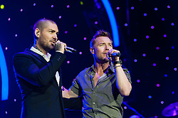 © Licensed to London News Pictures. 26/01/2013. London, UK.   Ronan Keating (right) and fellow Boyzone bandmate Shane Lynch (left) performing live during the encore of Ronan Keating's solo gig at The O2 Arena.  Ronan and Shane had just announced plans for Boyzone to tour the UK later in the year.  Ronan Keating is an Irish recording artist, singer-songwriter, musician, and philanthropist.  His solo career started in 1999.  Keating debuted on the professional music scene alongside Keith Duffy, Mikey Graham, Shane Lynch and Stephen Gately, in 1994 as the lead singer of Irish group Boyzone.  Photo credit : Richard Isaac/LNP
