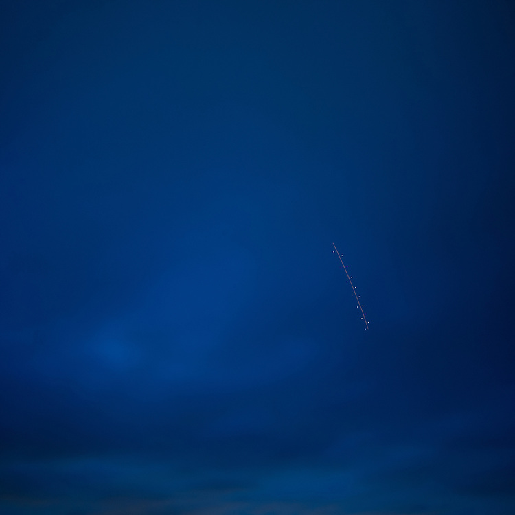 """""""Zipper in the Sky."""" View of the Hudson from Cold Spring. Light stripe in sky is from lights of a plane made with long exposure."""