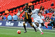 Stephen Forster  of Morpeth Town AFC holds off Mustapha Bundu of Hereford FC during the FA Vase match between Hereford FC and Morpeth Town at Wembley Stadium, London, England on 22 May 2016. Photo by Mike Sheridan.
