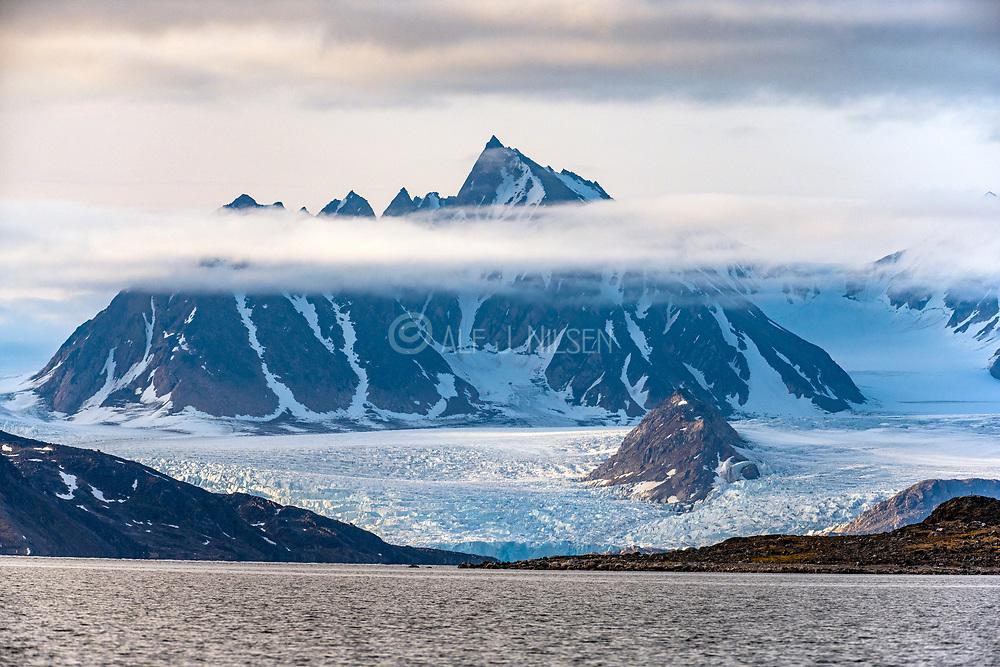 Precambrium rocks and glaciers in Smeerenburgfjorden, north-western Spitsbergen, Svalbard, Norway. Photo from August 2019.