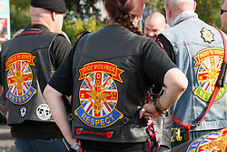 © Licensed to London News Pictures. 01/10/2011, Staafordshire, UK. The fourth annual Ride to the Wall took place today (Saturday). Thousands of motorcyclists from all over the country either as individuals or in groups rode to the National Memorial Arboretum to honour and show their support for the Armed Forces. Since the first ride in 2008 the ride has raised nearly £100,000 for the NMA. .Pictured, Badges of honour are sewn on bikers leathers..Photo credit : Dave Warren/LNP