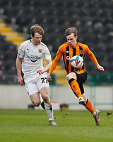 Hull City's Keane Lewis-Potter controls the ball under pressure from Oxford United's Rob Atkinson<br /> <br /> Photographer Lee Parker/CameraSport<br /> <br /> The EFL Sky Bet League One - Hull City v Oxford United - Saturday 13th March 2021 - KCOM Stadium - Kingston upon Hull<br /> <br /> World Copyright © 2021 CameraSport. All rights reserved. 43 Linden Ave. Countesthorpe. Leicester. England. LE8 5PG - Tel: +44 (0) 116 277 4147 - admin@camerasport.com - www.camerasport.com