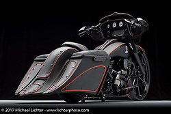 A black leather wrapped bagger built by Steve Hardy and Chris Fox of The Bike Exchange and upholstered by Steve Kurzman of Customs Stitching Co. in Gastonia, NC. Photographed by Michael Lichter during the Easyriders Bike Show in Columbus, OH on February 10, 2017. ©2017 Michael Lichter.