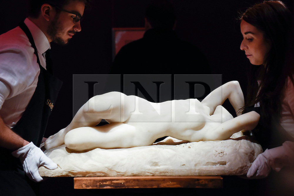 """© Licensed to London News Pictures. 10/02/2017. London, UK.  Technicians position """"La Grande Nevrose"""" by Jacques Loysel (est. GBP120-180k), at the preview of the """"Erotic: Passion & Desire"""" sale at Sotheby's in New Bond Street.  The sale, which will take place on 16 February, encompasses representations of love and sex from antiquity to the present day.  Photo credit : Stephen Chung/LNP"""