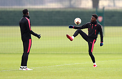 Arsenal's Ainsley Maitland-Niles (right) during the training session at London Colney, Hertfordshire. PRESS ASSOCIATION Photo. Picture date: Wednesday March 7, 2018. See PA story SOCCER Arsenal. Photo credit should read: Tim Goode/PA Wire