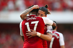 Arsenal's Alex Iwobi celebrates scoring his side's fourth goal of the game with team mae Arsenal's Hector Bellerin