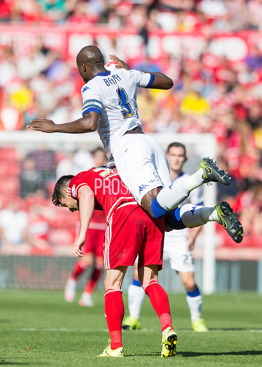 Leeds United FC defender Souleman Bamba   rises above Middlesbrough FC striker David Nugent to win the ball during the Sky Bet Championship match between Middlesbrough and Leeds United at the Riverside Stadium, Middlesbrough, England on 27 September 2015. Photo by George Ledger.