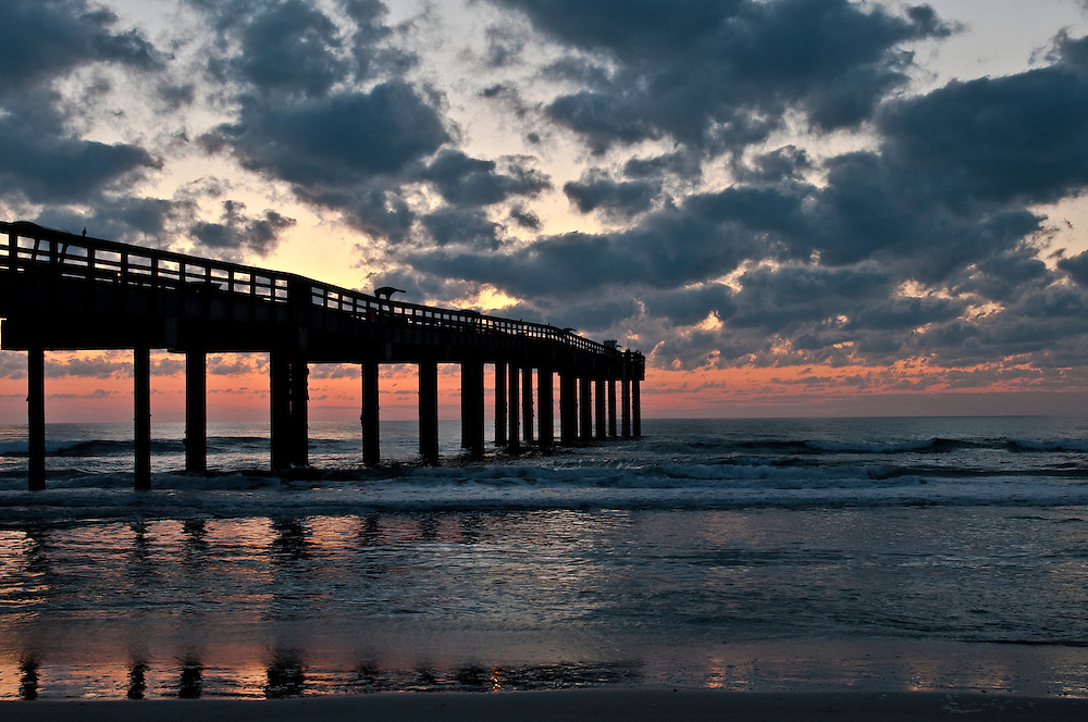 Sunrise at St. Augustine fishing pier in Florida.