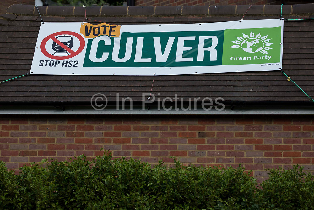 A campaign banner for the Green Party candidate Carolyne Culver is pictured on the eve of the Chesham and Amersham by-election on 16th June 2021 in Chesham, United Kingdom. The by-election was triggered by the death of Dame Cheryl Gillan, who had been the constituency's MP for 29 years, and it is expected to be a tight race between the Conservatives and the Liberal Democrats.