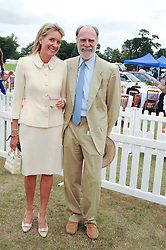 VISCOUNT & VISCOUNTESS COWDRAY at the Veuve Clicquot Gold Cup polo final held at Cowdray Park, Midhurst, West Sussex on 18th July 2010.