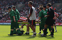 Photo: Alan Crowhurst.<br /> Southampton v Norwich City. Coca Cola Championship.<br /> 20/08/2005. Claus Lundekvam is carried from the field after a bad collision.
