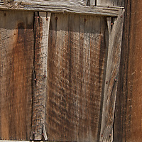 Old weathered wood covers the wall of a building in  Virginia City, a ghost town that was once the capital of Montana Territory.