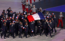 France flag-bearer Martin Fourcade during the Opening Ceremony of the PyeongChang 2018 Winter Olympic Games at the PyeongChang Olympic Stadium in South Korea. PRESS ASSOCIATION Photo. Picture date: Friday February 9, 2018. See PA story OLYMPICS Ceremony. Photo credit should read: David Davies/PA Wire. RESTRICTIONS: Editorial use only. No commercial use