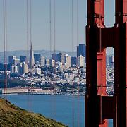 View past the Golden Gate Bridge toward downtown San Francisco from Golden Gate National Recreation Area, California.