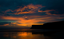 © Licensed to London News Pictures. 29/08/2012..Saltburn Beach, Cleveland, England..Sunrise over Huntcliff on Saltburn beach in Cleveland..Photo credit : Ian Forsyth/LNP