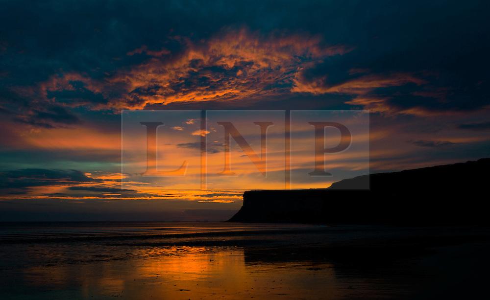 © Licensed to London News Pictures. 29/08/2012..Saltburn Beach, Cleveland, England..Sunrise over Huntcliff on Saltburn beach in Cleveland..Photo credit : Ian Forsyth/LNP