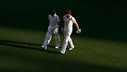 Australia's Shaun Marsh and Steve Smith walk off at the end of play during day two of the Ashes Test match at The Gabba, Brisbane.