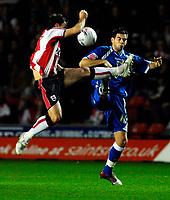 Photo: Alan Crowhurst.<br />Southampton v Cardiff City. Coca Cola Championship. 13/03/2007. Cardiff's Joe Ledley (R) goes in hard.