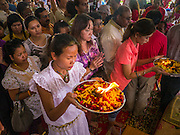 """29 SEPTEMBER 2012 - NAKORN NAYOK, THAILAND: Thai Buddhists seek the blessings of Ganesh during observances of Ganesh Ustav at Wat Utthayan Ganesh, a temple dedicated to Ganesh in Nakorn Nayok, about three hours from Bangkok. Many Thai Buddhists incorporate Hindu elements, including worship of Ganesh into their spiritual life. Ganesha Chaturthi also known as Vinayaka Chaturthi, is the Hindu festival celebrated on the day of the re-birth of Lord Ganesha, the son of Shiva and Parvati. The festival, also known as Ganeshotsav (""""festival of Ganesha"""") is observed in the Hindu calendar month of Bhaadrapada, starting on the the fourth day of the waxing moon. The festival lasts for 10 days, ending on the fourteenth day of the waxing moon. Outside India, it is celebrated widely in Nepal and by Hindus in the United States, Canada, Mauritius, Singapore, Thailand, Cambodia, Burma , Fiji and Trinidad & Tobago.      PHOTO BY JACK KURTZ"""