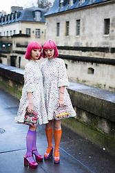 Asian twins Amiaya with pink hair wearing white dress seen outside Valentino during Paris Fashion Week Womenswear Fall/Winter 2018/2019 on March 4, 2018 in Paris, France. (Photo by Nataliya Petrova/NurPhoto/Sipa USA)