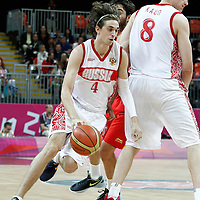 04 August 2012: Russia Alexey Shved drives past Spain Juan-Carlos Navarro on a screen set by Sasha Kaun during 77-74 Team Russia victory over Team Spain, during the men's basketball preliminary, at the Basketball Arena, in London, Great Britain.