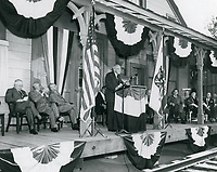 1956 CB DeMille addressing the audience during the dedication of the DeMille/Lasky barn at Paramount Studios