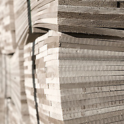 Black and white image of a pallet of cedar shingles used for house siding
