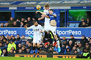 Alexander Sorloth of Crystal Palace (c) jumps for the ball with Luka Milivojevic of Crystal Palace (l) and Michael Keane of Everton (r). Premier league match, Everton v Crystal Palace at Goodison Park in Liverpool, Merseyside on Saturday 10th February 2018. pic by Chris Stading, Andrew Orchard sports photography.