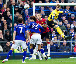 29.10.2011, Goodison Park, Liverpool, ENG, PL, Everton FC vs Manchester United FC, im Bild Everton's Marouane Fellaini in action against Manchester United's goalkeeper David de Gea and captain Nemanja Vidic during the Premiership match at Goodison Park // during FA Premiere League Football match between Everton and vs Manchester United FC at Goodison Park, Liverpool, United Kingdom on 29/10/2011. EXPA Pictures © 2011, PhotoCredit: EXPA/ Propaganda Photo/ Vegard Grott +++++ ATTENTION - OUT OF ENGLAND/GBR+++++